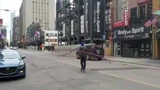 Activist Dons Weird Social Distancing Machine In Street