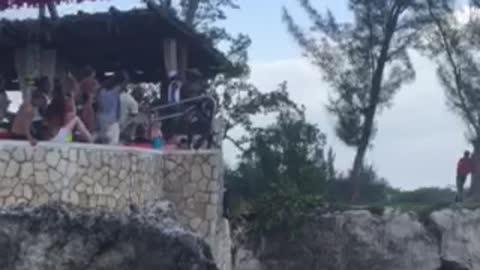 Insane cliff diver risks all for jump