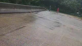 Flash Flooding Forces Debris Under Bridge
