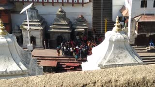Pyre funeral ceremony, burning a corpse in Bagmati River, Pashupatinath Temple, Kathmandu