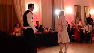 Groom and his mom pull off awesome mashup dance