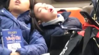 Man and woman asleep on each other