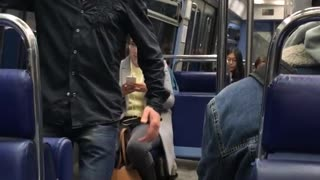 Old man black button up dancing on train