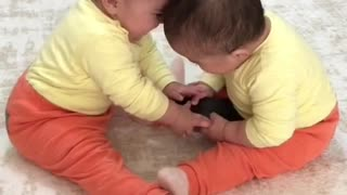 Children fighting for iPhone 12