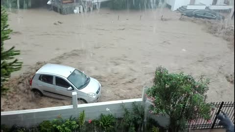 Extreme flooding in Greece sends cars into the sea