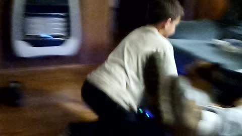 Grandson safely riding hoverboard