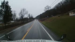 Driver Passing a Semi Has a Close Call