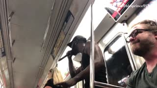 Guy singing over cardi b on subway train