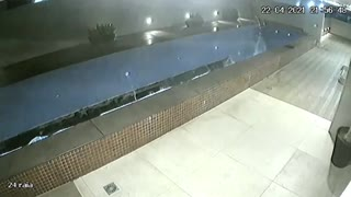 Caught On Camera - Swimming Pool Collapses into Parking Lot