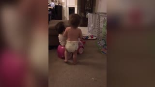 Twins Play with Toy Car in a Unique Way