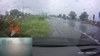 Truck Causes Close Call on Rainy Road