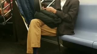 Man in wizard old man costume on train