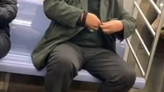 Man clips his fingernails on a subway train