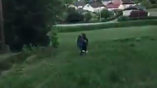 Two girls on tandem bike fall downhill