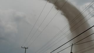 Whirling Tornado Spawns from Thunderstorm over Hidalgo