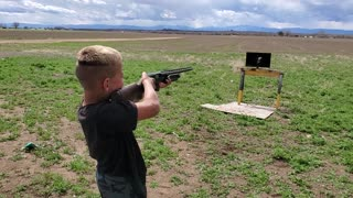 Son shooting 12 guage at tv first time