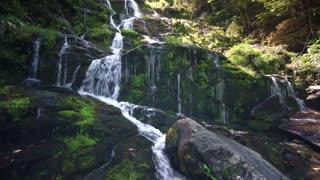 Beautiful Water fall rocky hillside