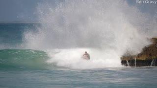 Surfer Makes a Tight Squeeze