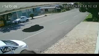 Hole Swallows Car Whole