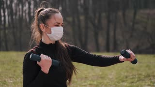 Woman Exercising While Wearing a Face Mask