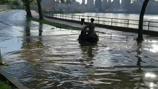Delivery Driver Makes the Most of Flooded Street