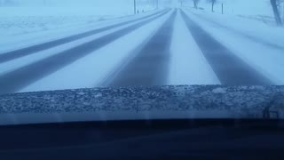 Driving on a snowing afternoon day