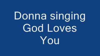 Donna singing God Loves You