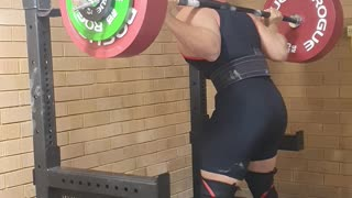 Epic fails: Powerlifter sent flying by squat rack