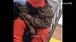 Guy on subway picks scabs on his arms until they bleed