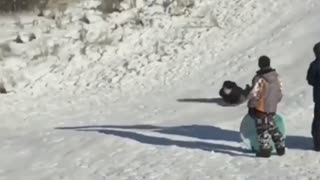 Face Meets Snow in Slow Motion Sledding