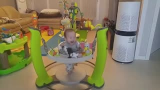 Little baby riding jumperoo