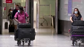 EU, U.S. travellers fly in as England rules alter