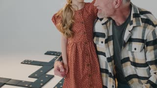 Little Girl with Her Grandfather