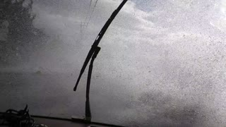 Waves Crash over Road During Storm Surge