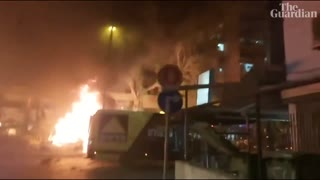 Israeli airstrikes demolish tower block and Hamas rocket hits bus as violence escalates