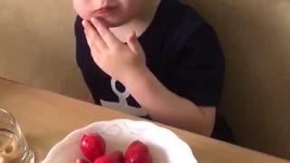 Artem eats strawberries