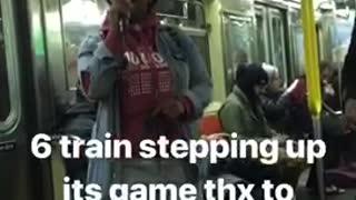 Woman in red hoodie sings beautifully on subway train, man plays red guitar