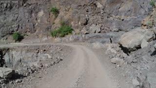 Mountain fell on road.