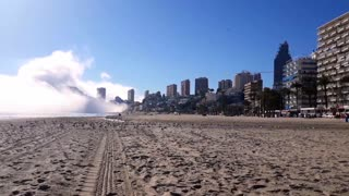 Time-Lapse of Cloud Bank Enveloping Beach