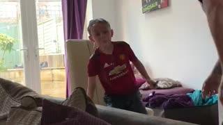 Dad Surprises Son with Hidden Water Balloon Gag