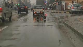 A Funny Way to Transport a Metal Cart