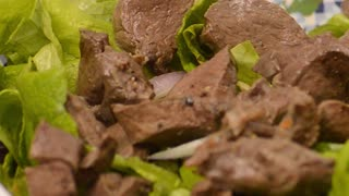 Boiled liver on lettuce leaves - Footage By Peakring.com