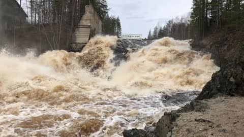 Rough current at the dam, slow motion video