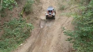 Off Road Vehicle Rolls Back Down Massive Hill