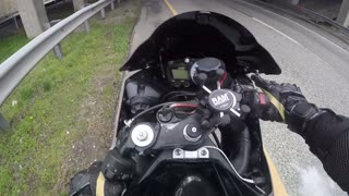 Motorcyclist Walks Away from Highway Tumble