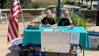 Girls sell lemonade to raise money for family of fallen Colorado police officer