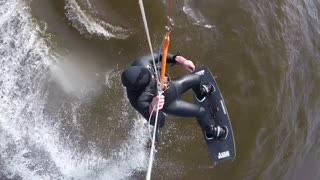 kitesurfing - trying a double back roll