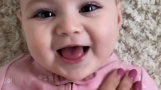 Cute Baby Playing with Mom