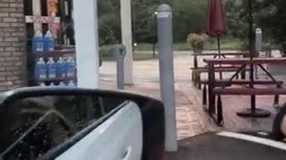 Guy jumps over pole gets shorts stuck falls