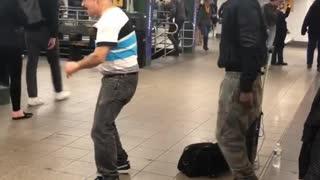White polo strips dancing subway guy rapping singing